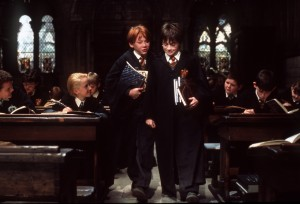"L-R, Ron Weasley (Rupert Grint) and Harry Potter (Daniel Radcliffe) arrive late to class in Warner Bros. Pictures; family adventure movie ""HARRY POTTER AND THE SORCERER'S STONE."" photo by Peter Mountain. CURRENT MOVIE SKED RELEASE NOV 16."