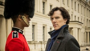 Benedict Cumberbatch as Sherlock Holmes with Alfie Enoch as Bainbridge, the bloody guardsman in BBC Sherlock Season 1 Episode 2 The Sign o