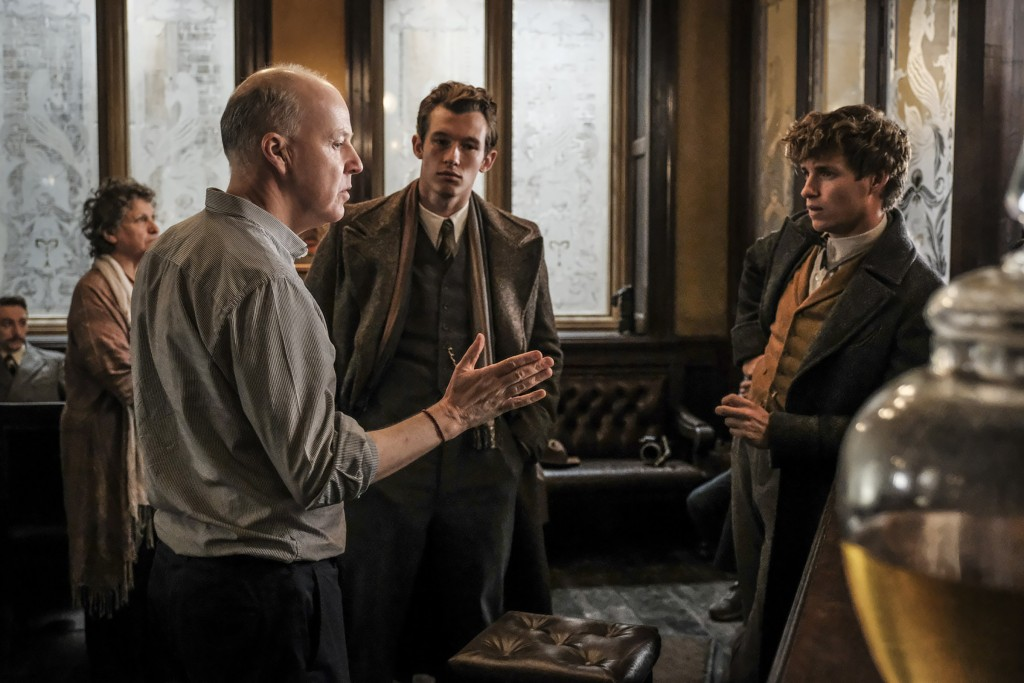 Photo by Jaap Buitendijk (exclusive for Leaky's set visit reports, showing Callum Turner (Theseus Scamander) and Eddie Redmayne (Newt Scamander) on set with director David Yates for 'Crimes of Grindelwald')