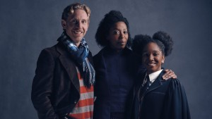 This is a family portrait of Ron (Paul Thornley), Hermione (Noma Dumezweni), and Rose (Cherelle Skeete).