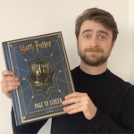 Daniel Radcliffe poses with his entry for the Cumming Club auction!
