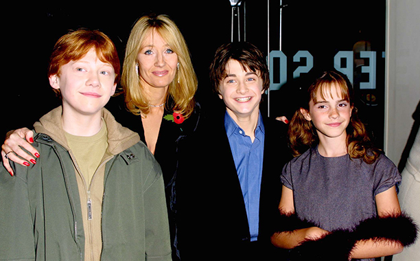 "LONDON - NOVEMBER 4:  (L to R) Rupert Grint (Ron Weasley), author J.K. Rowling, Daniel Radcliffe (Harry Potter) and Emma Watson (Hermione Granger) attend the world film premiere of ""Harry Potter and The Philosopher's Stone"" at the Odeon Leicester Square cinema in London on November 4, 2001. The film is titled ""Harry Potter and The Sorcerer's Stone"" for it's U.S. release. (Photo by Gareth Davies/Getty Images)"