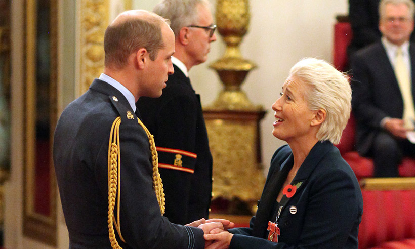 Emma Thompson (right) is made a Dame Commander of the British Empire by the Duke of Cambridge (left) at Buckingham Palace.